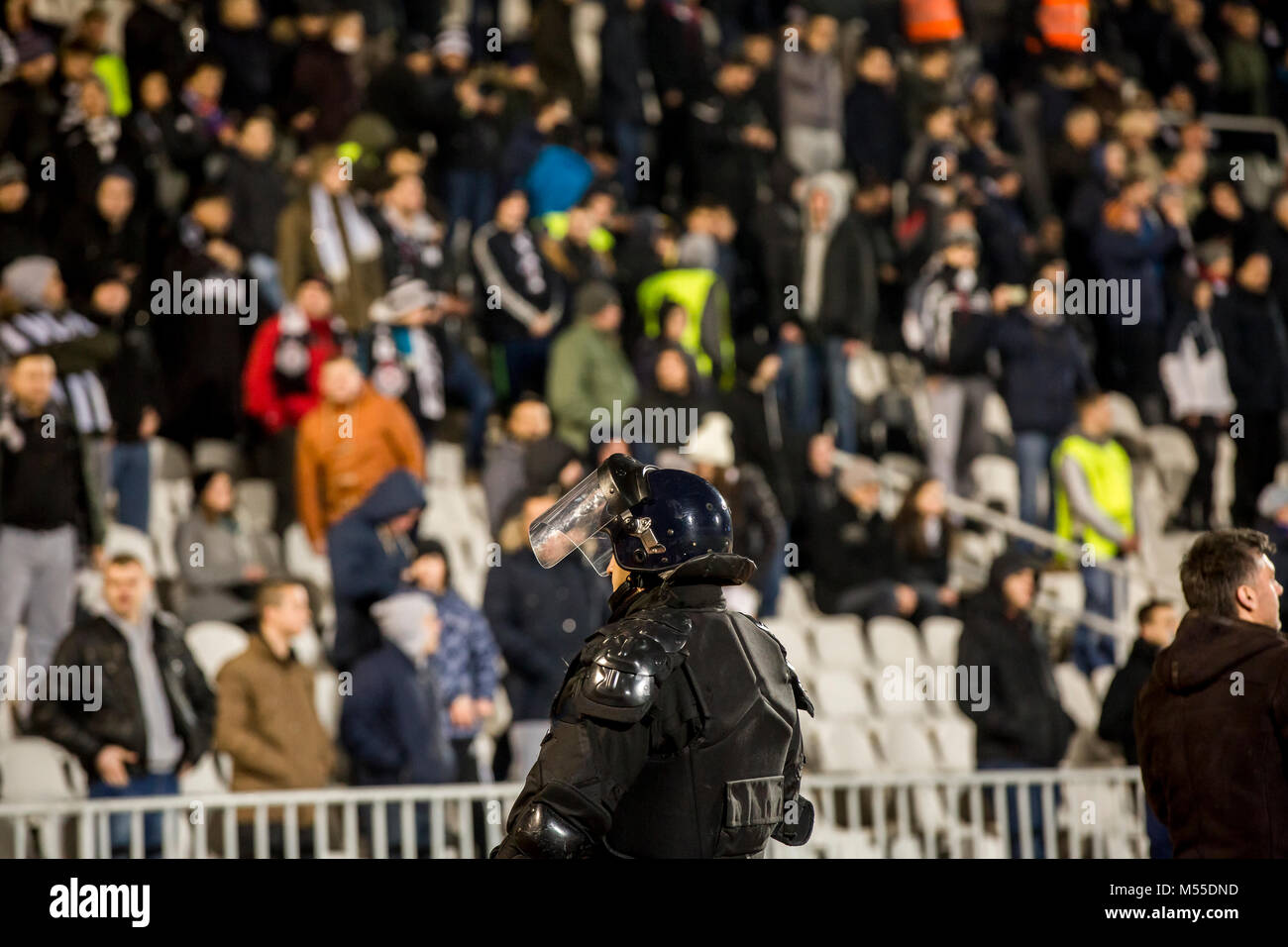 The police at the stadium event secure a safe match against the hooligans Stock Photo