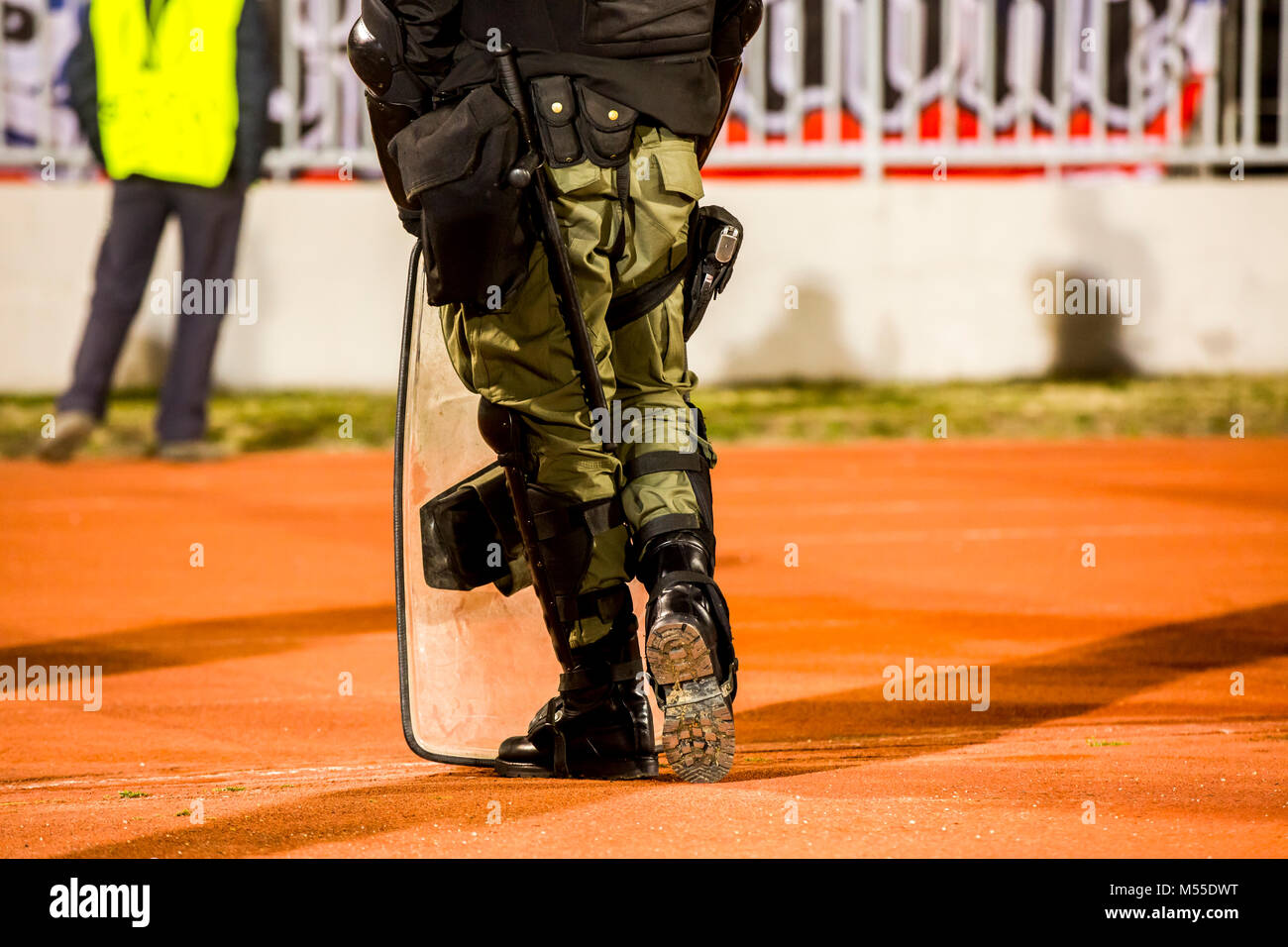 Special police unit at the stadium event secure a safe match against the hooligans - Stock Image