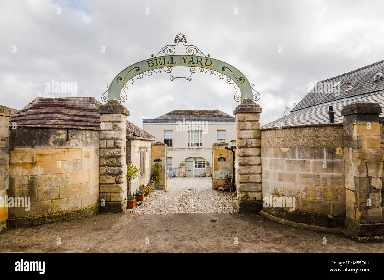 Bell House, historic Georgian town house with Cotswold stone entrance wall and pillars, Painswick, an unspoilt village - Stock Image