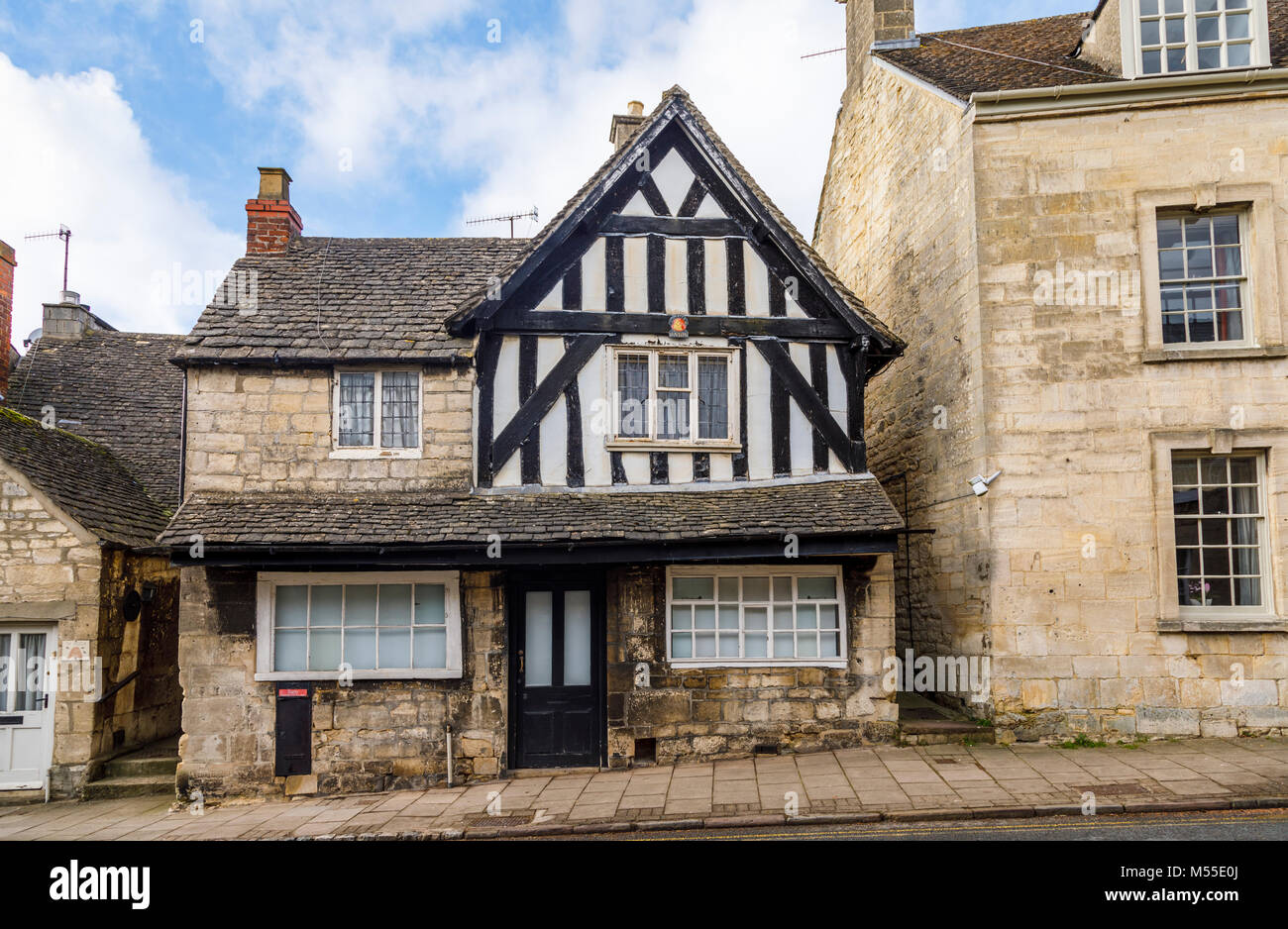 Sightseeing: Historic timbered house and Cotswold stone buildings in New Street, Painswick, an unspoilt village - Stock Image