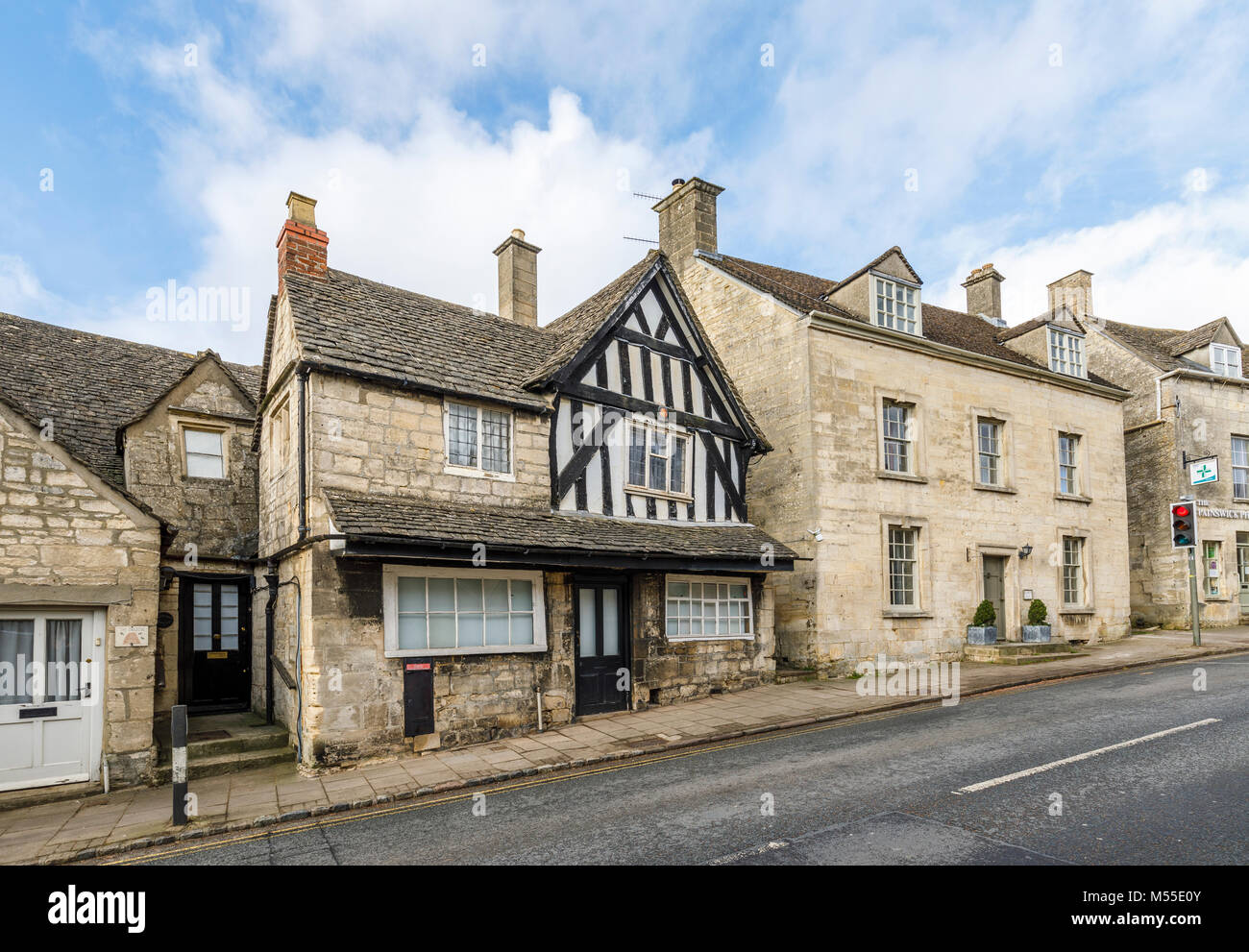 Sightseeing: Historic timbered house and Cotswold stone buildings in New Street, Painswick, an unspoilt village Stock Photo
