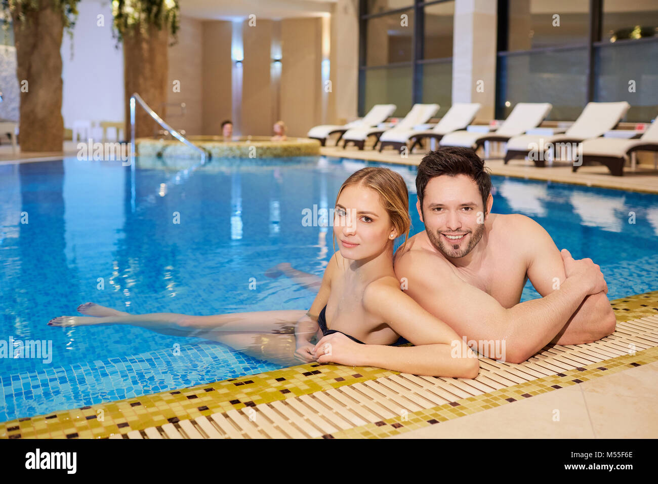 Couple in bathing suits in the pool resting spa center Stock Photo ...