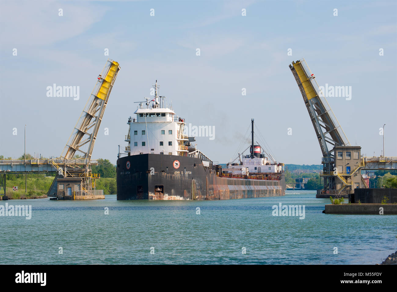 The John D. Leitch self-discharging bulk carrier navigating through the Welland Canal, Ontario, Canada - Stock Image