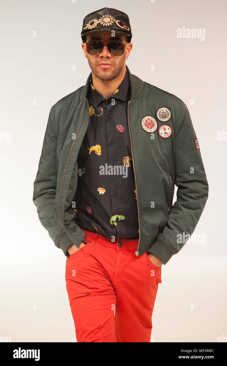 Model wearing Ben Sherman jacket, Carlos Cordoba animal print shirt and Ethnic Blue red chinos on the catwalk at - Stock Image