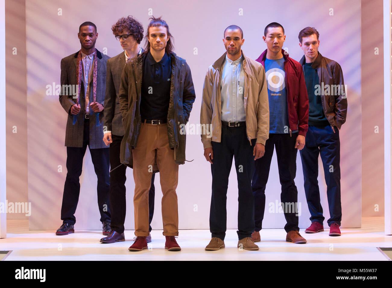 Male models on the menswear catwalk wearing designs by Lambretta at Moda.The trade fashion show ran 18th-20th February - Stock Image
