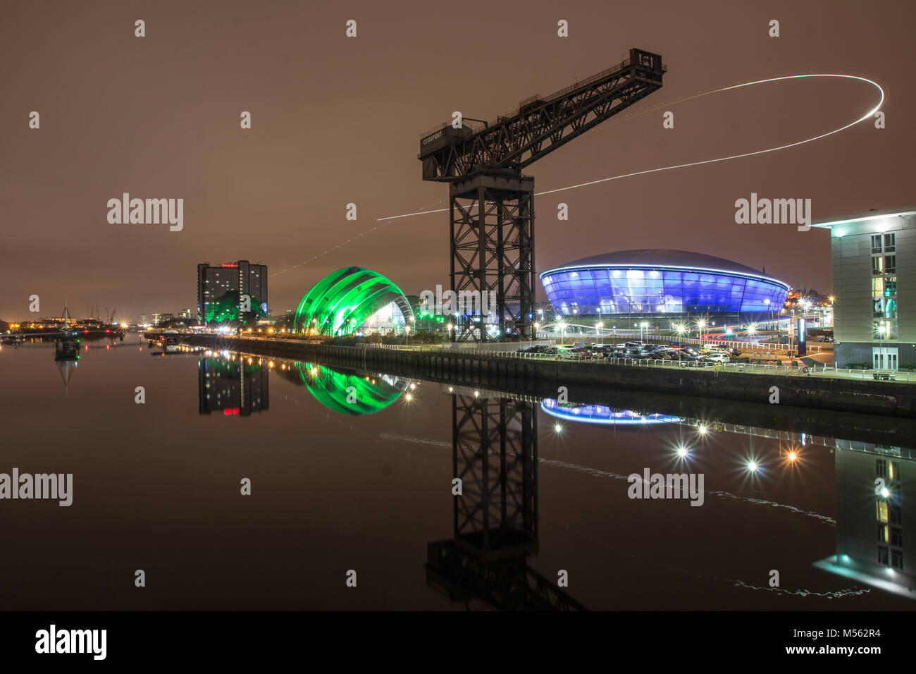 A shot of the Hydro and The Armadillo at the SECC, Glasgow. The Light trail is a helicopter which doubled back giving - Stock Image