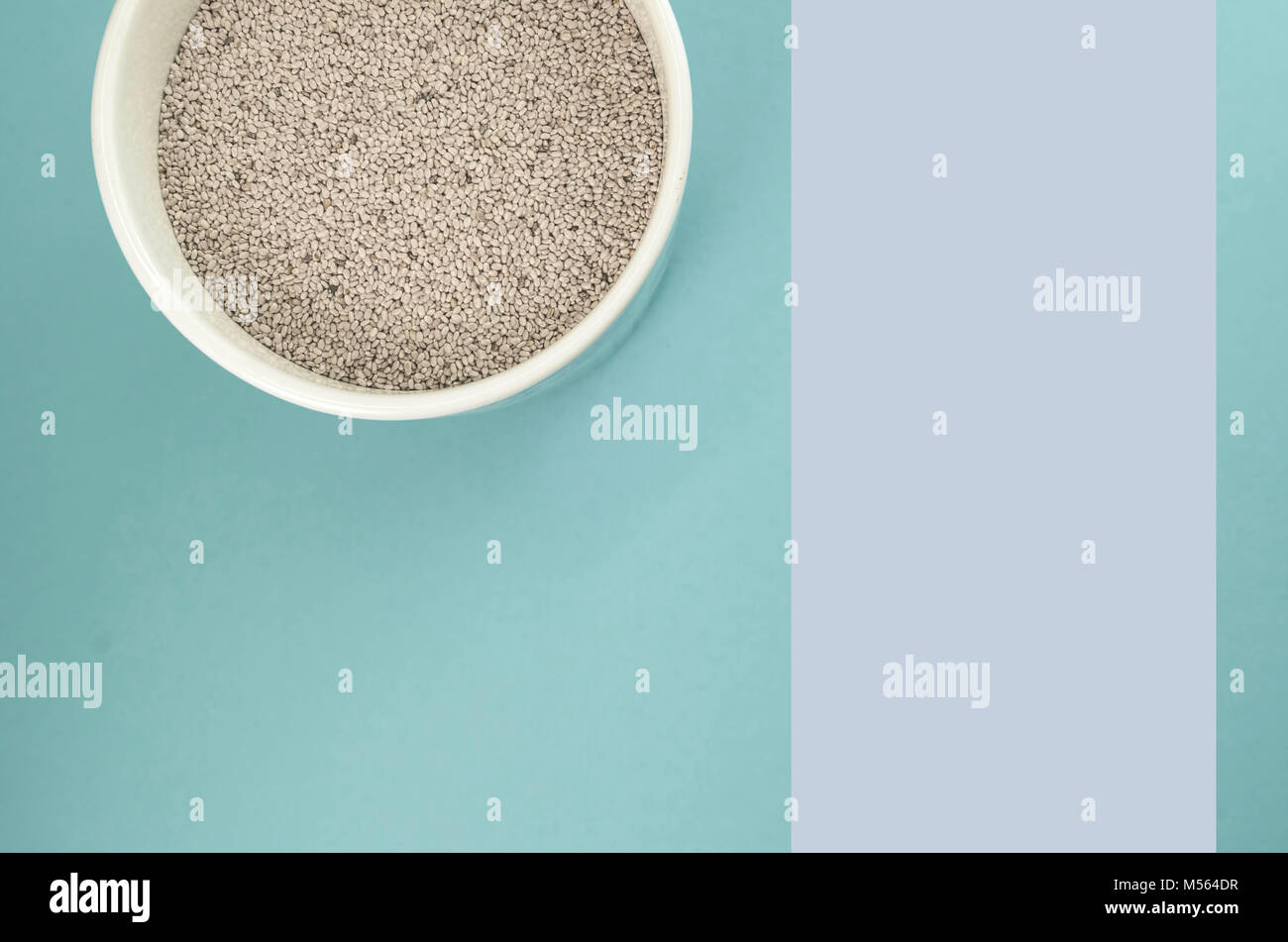 dry chia seeds in a white porcelain jar - directly above view - Stock Image