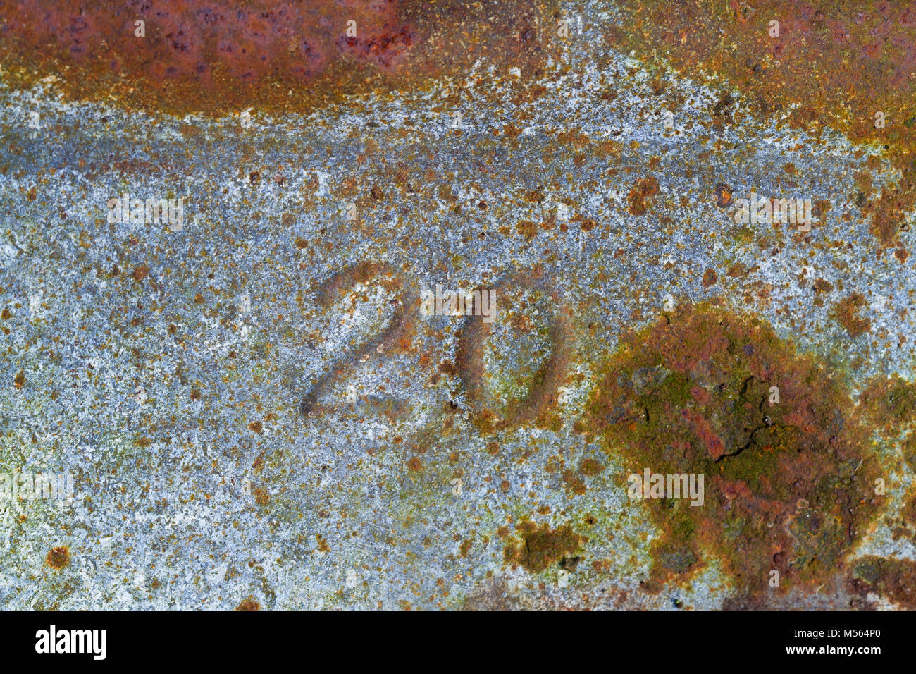 Number '20' pressed in  corroded, rusty galvanized iron - Stock Image