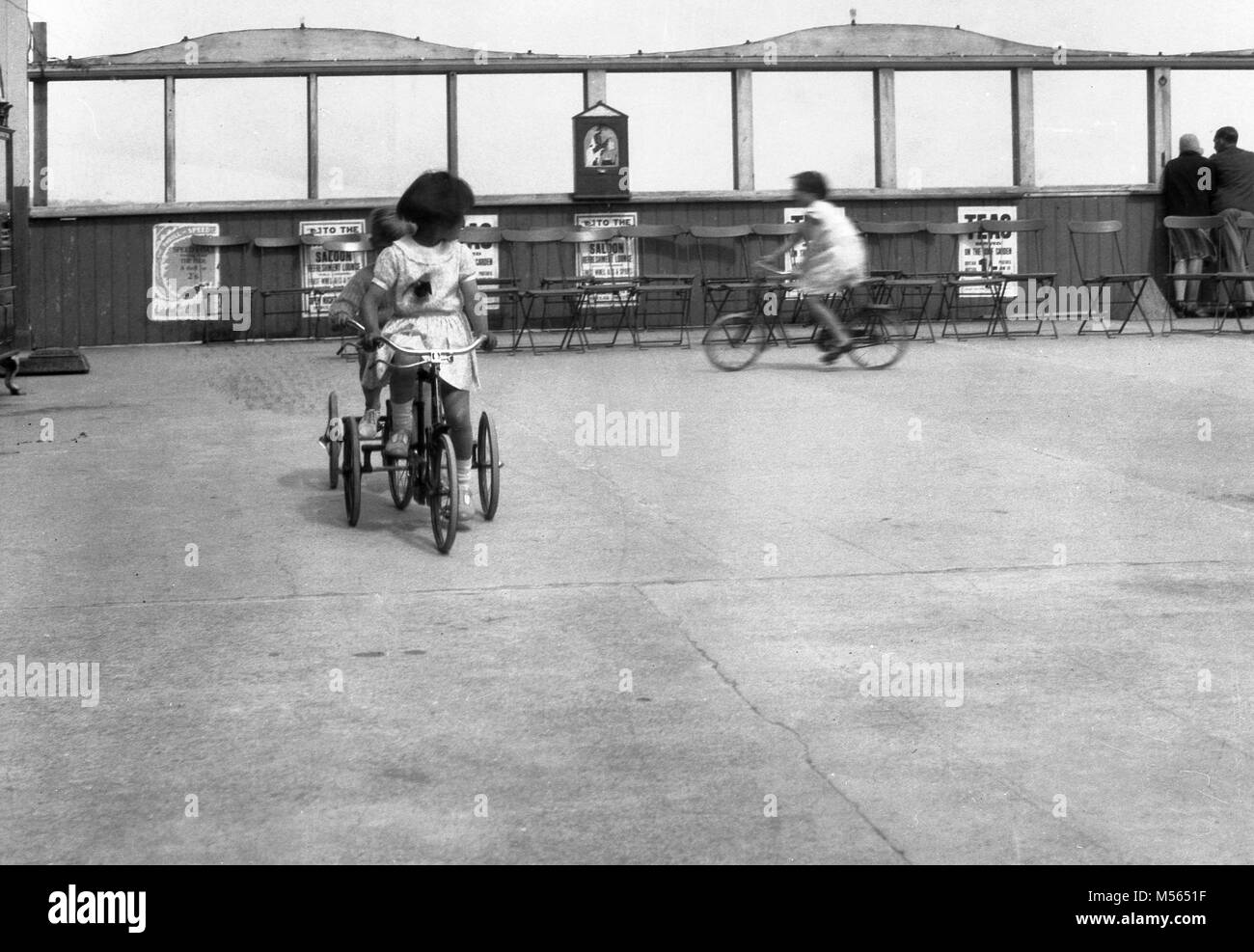1930s, historical, childrern cycling outdoor in a special area on a seaside pier, England. - Stock Image