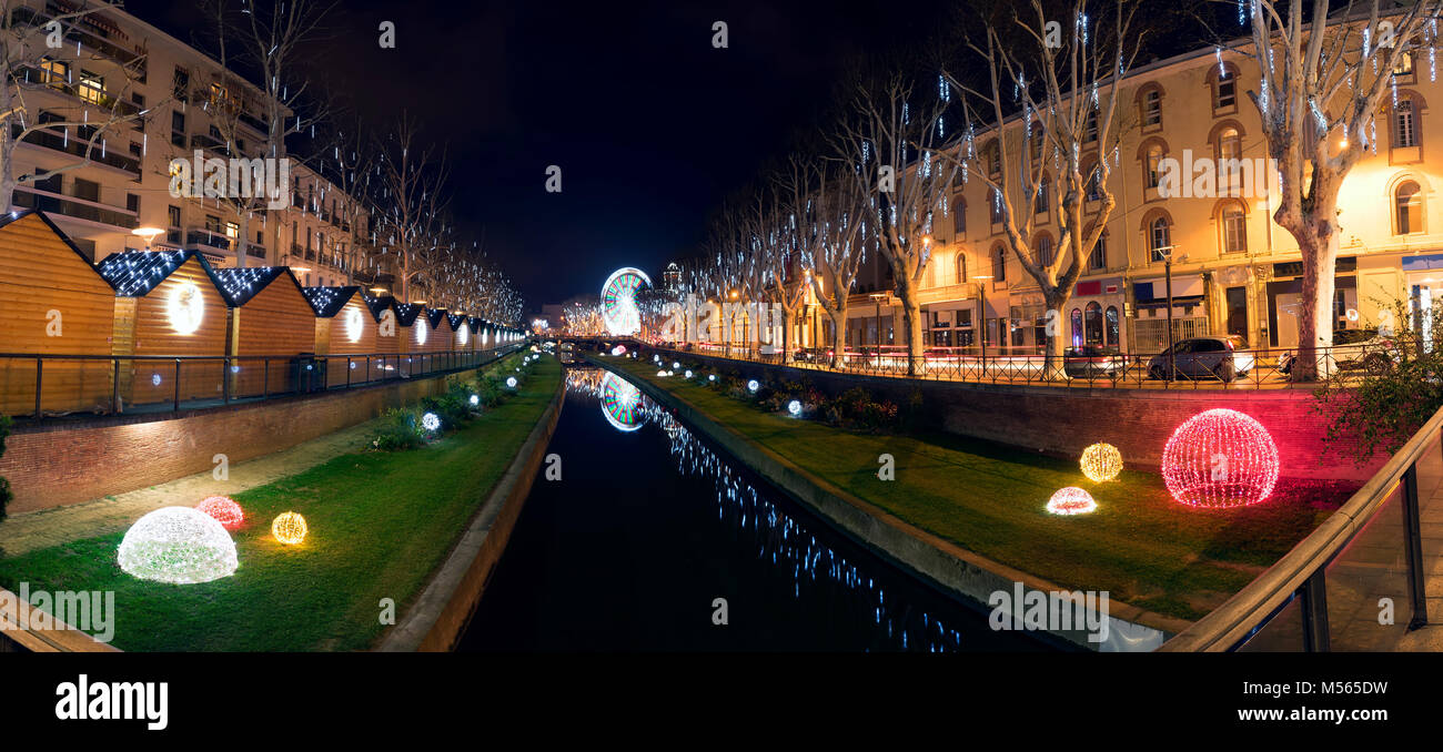 Night view of the city of Perpignan (France) during Christmas time. Beautiful lights and  a the touch a a fair with - Stock Image