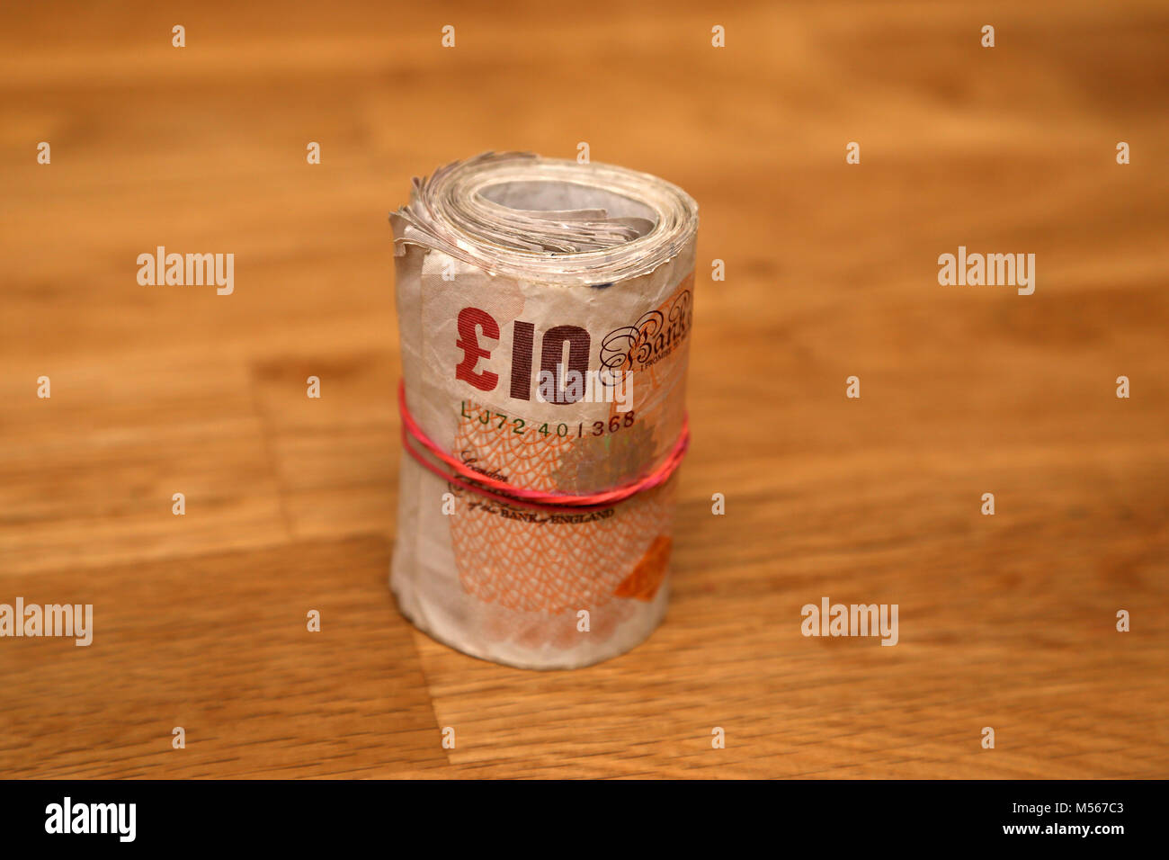 Bank of England notes including the old paper £10 note, paper £20 note, plastic £10 note and plastic - Stock Image