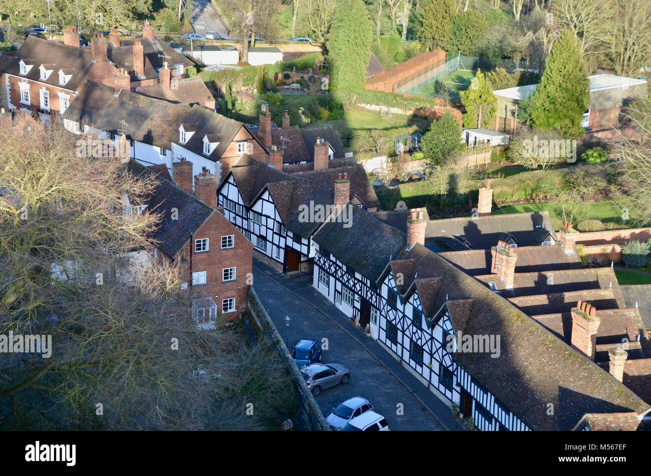 a street of tudor houses in the shadow of warwick castle - Stock Image