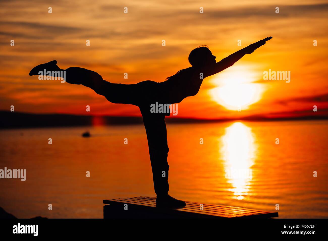Carefree woman meditating in nature.Finding inner peace.Yoga practicing.Spiritual healing lifestyle.Enjoying peace,anti - Stock Image
