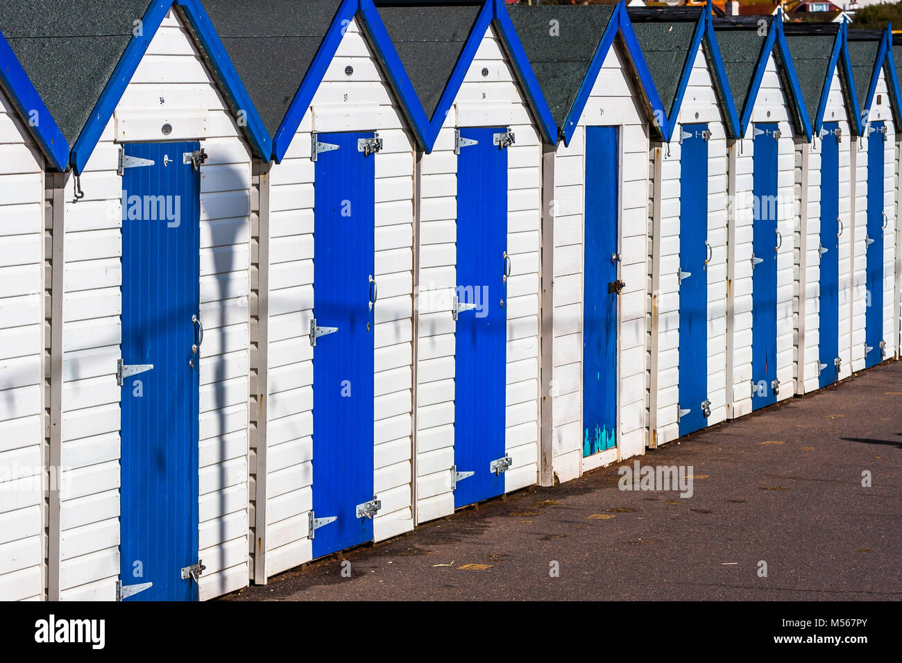 A row of beach huts on the Devon coast of England. - Stock Image
