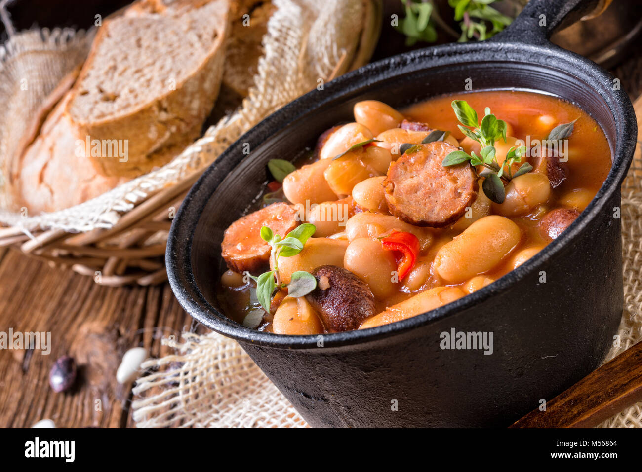 Polish Baked Beans with sausage - Stock Image