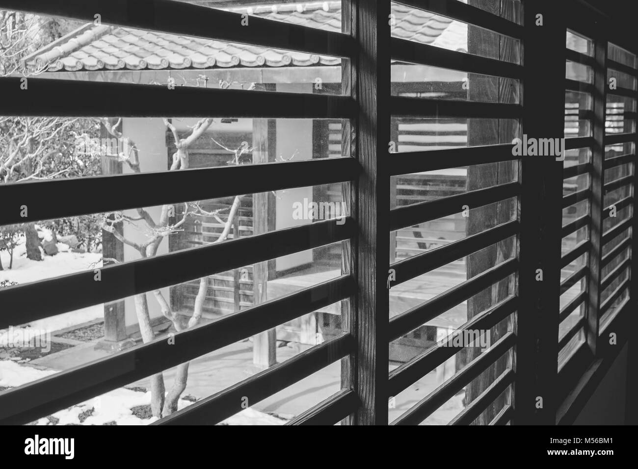 Abstract black and white image of architecture interior of wooden window blind inside the Kawagoe Castle, Japan. - Stock Image