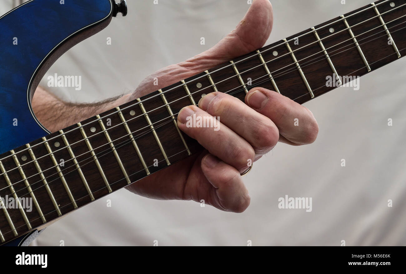 On the Fretboard, playing chords - Stock Image