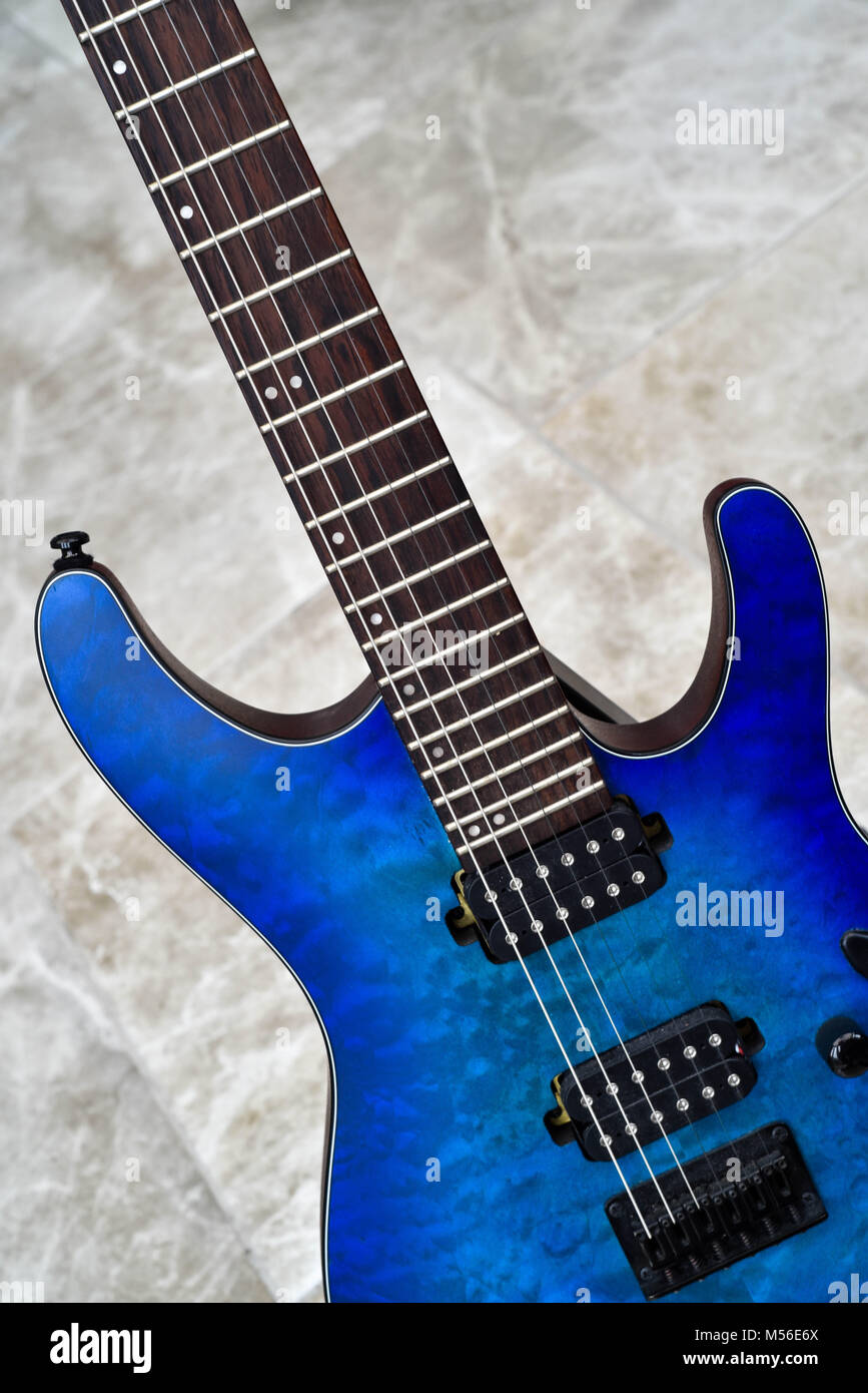Bright blue guitar - Stock Image