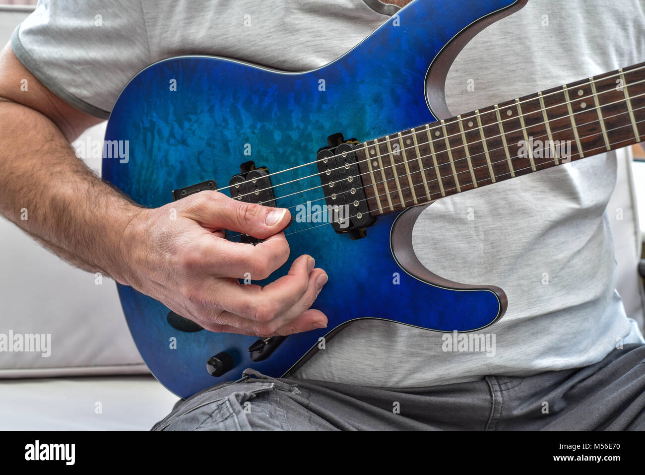 Playing the guitar - Stock Image