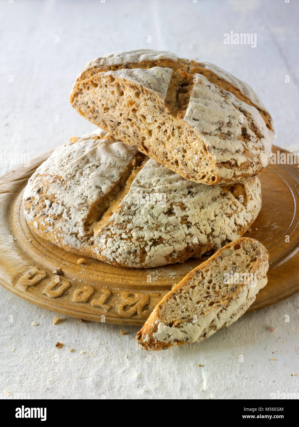 Hand made artisan sour dough wholemeal seed bread made with white, malted and rye flour - Stock Image