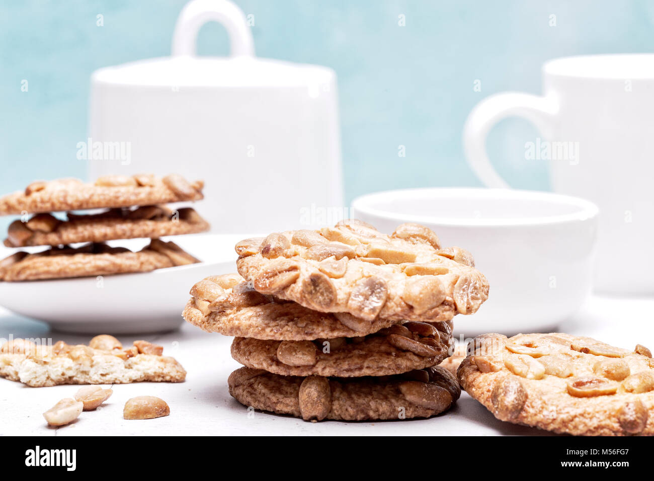 Peanut cookies in a light blue and white kitchen setting - Stock Image