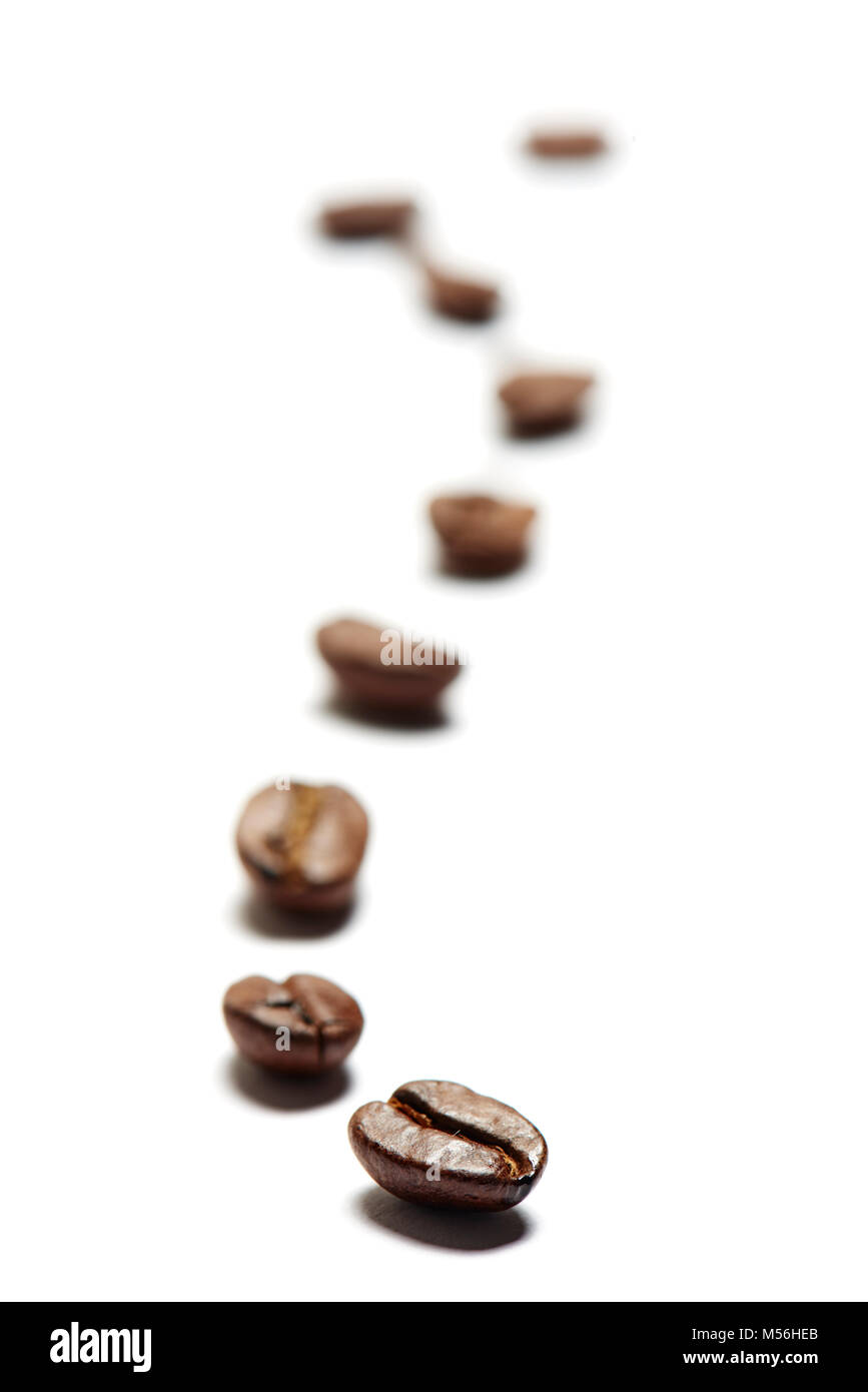 Eine Reihe Kaffeebohnen - Stock Image