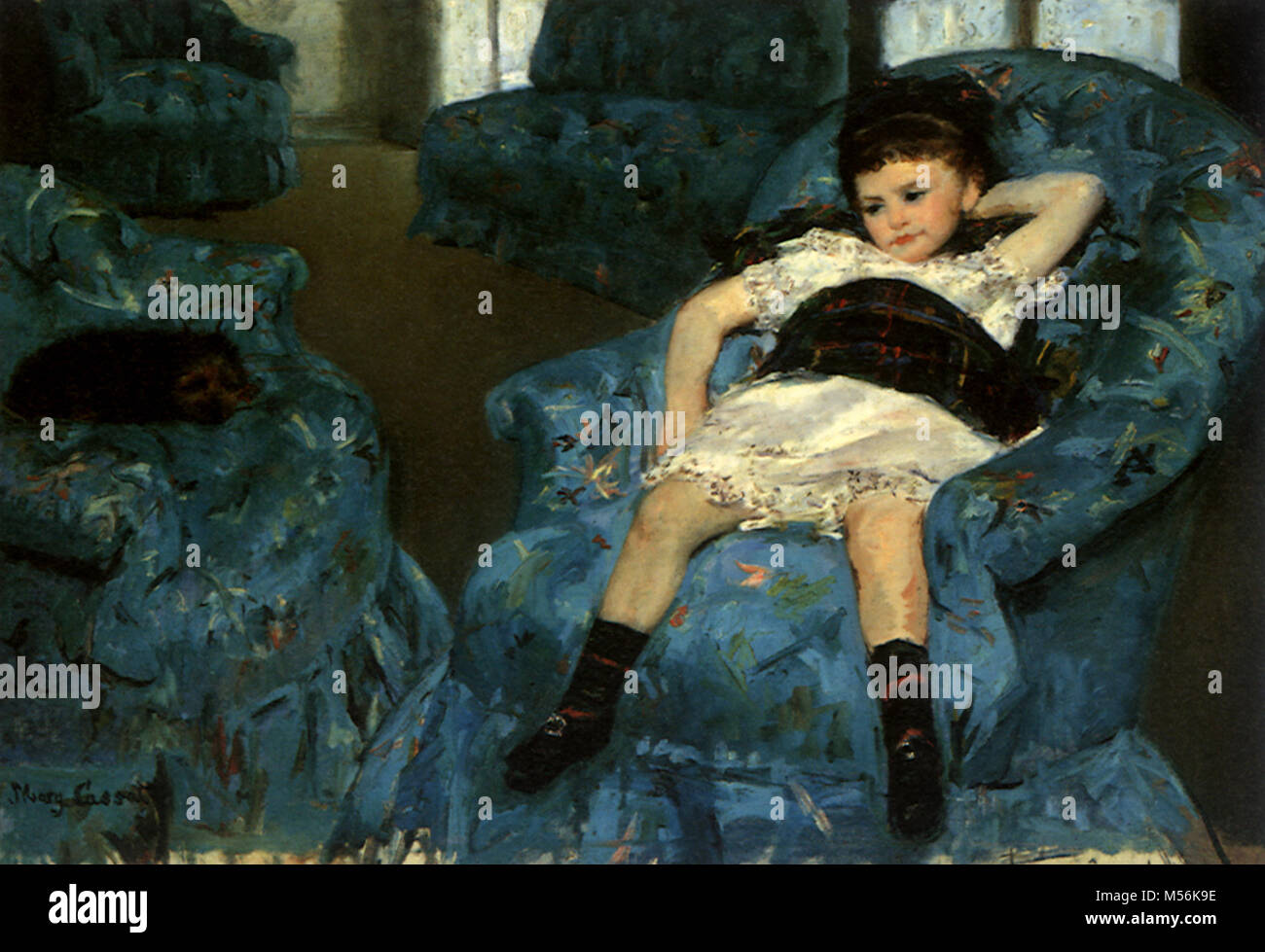 little girl in a blue armchair stock photo 175323834 alamy