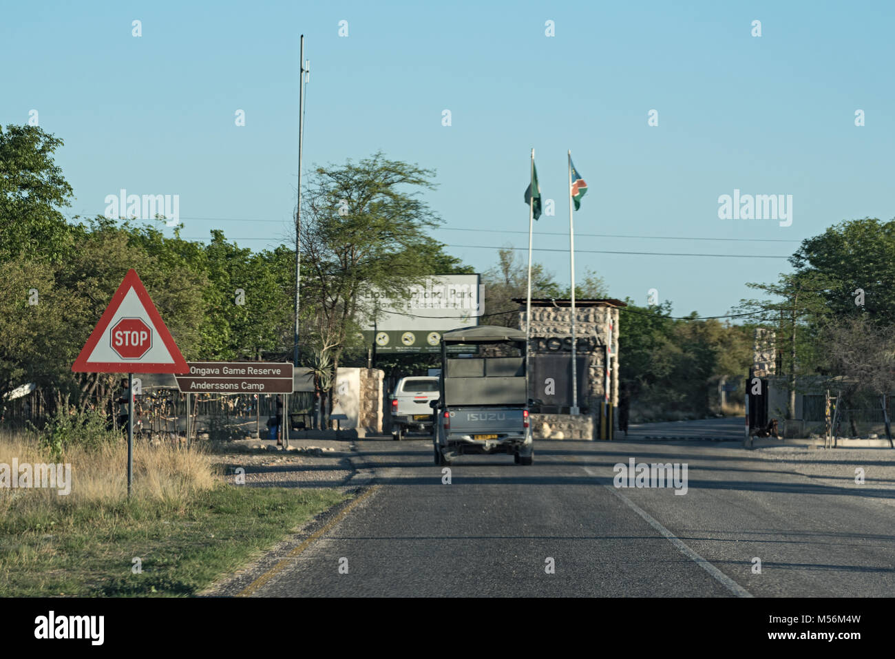 drive cars are waiting to buy tickets at the Anderson gate of Etosha National Park - Stock Image