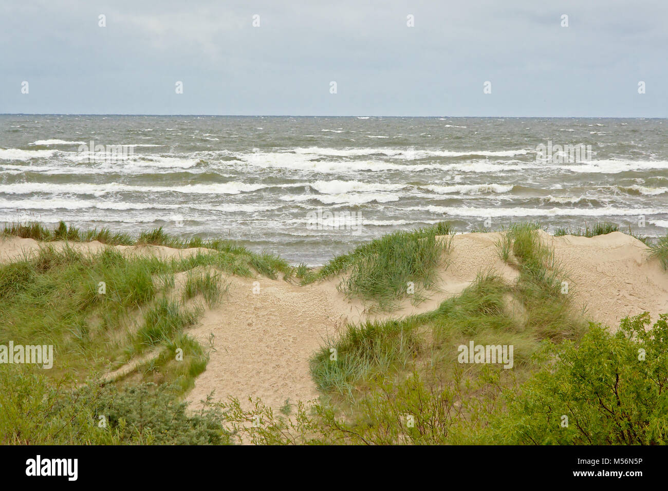 Dunes on the Baltic sea coast of Liepaja on a cloudy day, - Stock Image