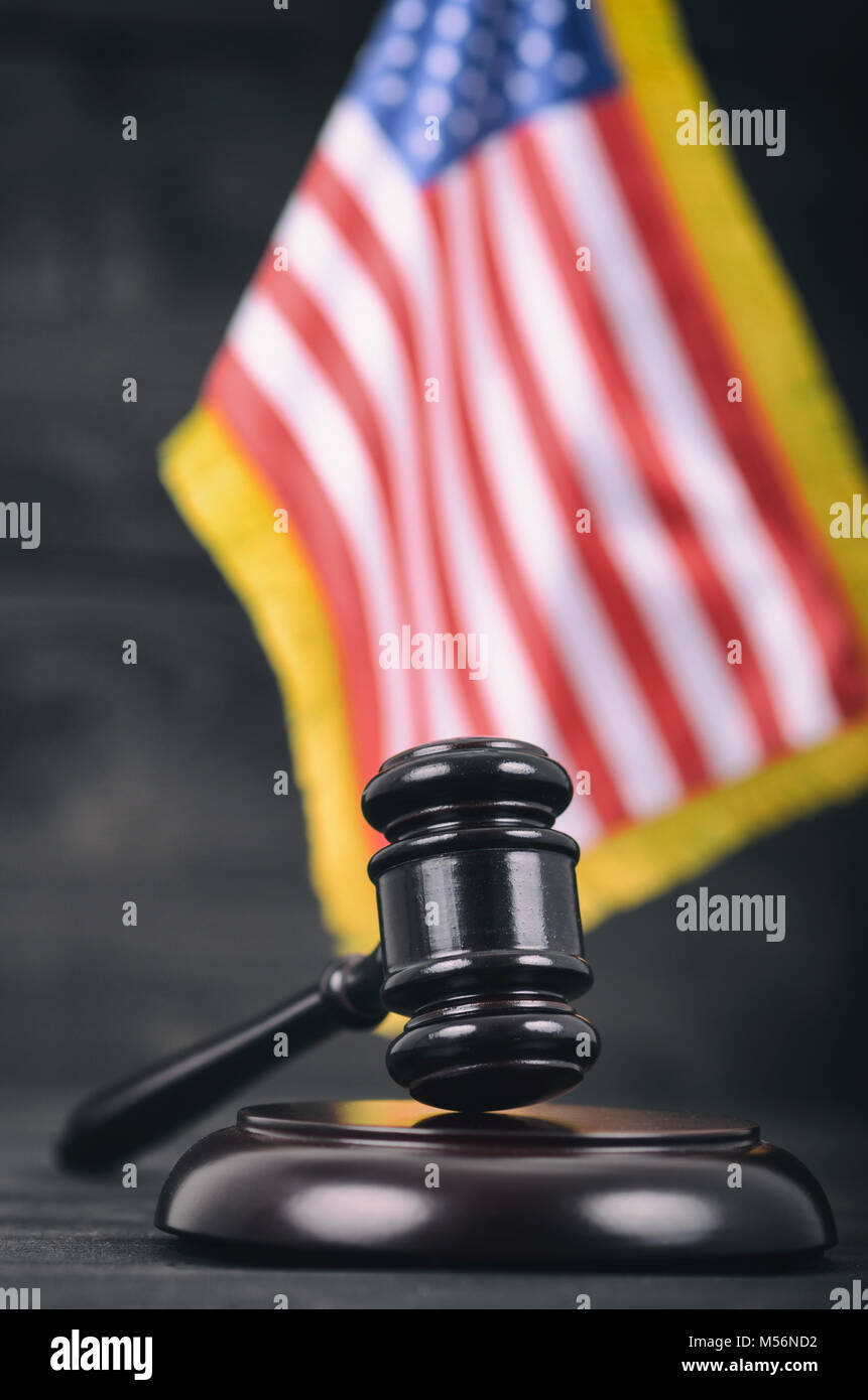 Law and Justice, Legality concept, Judge Gavel and United States of America flag on a black wooden background. - Stock Image