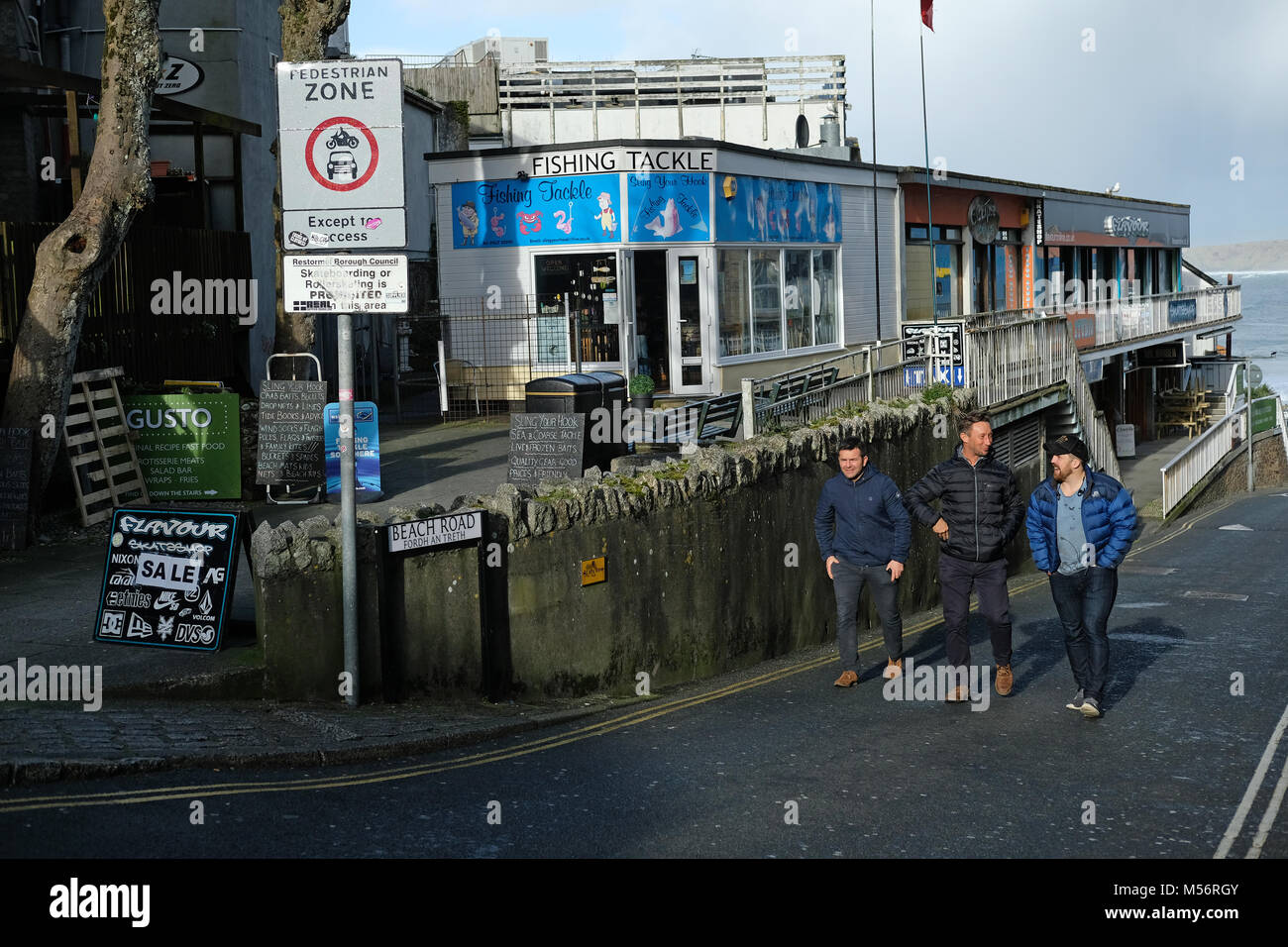 Young men in Newquay, Cornwall. - Stock Image