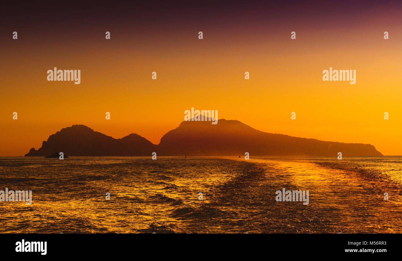 Sunset over the island of Capri, Bay of Naples, Italy. - Stock Image