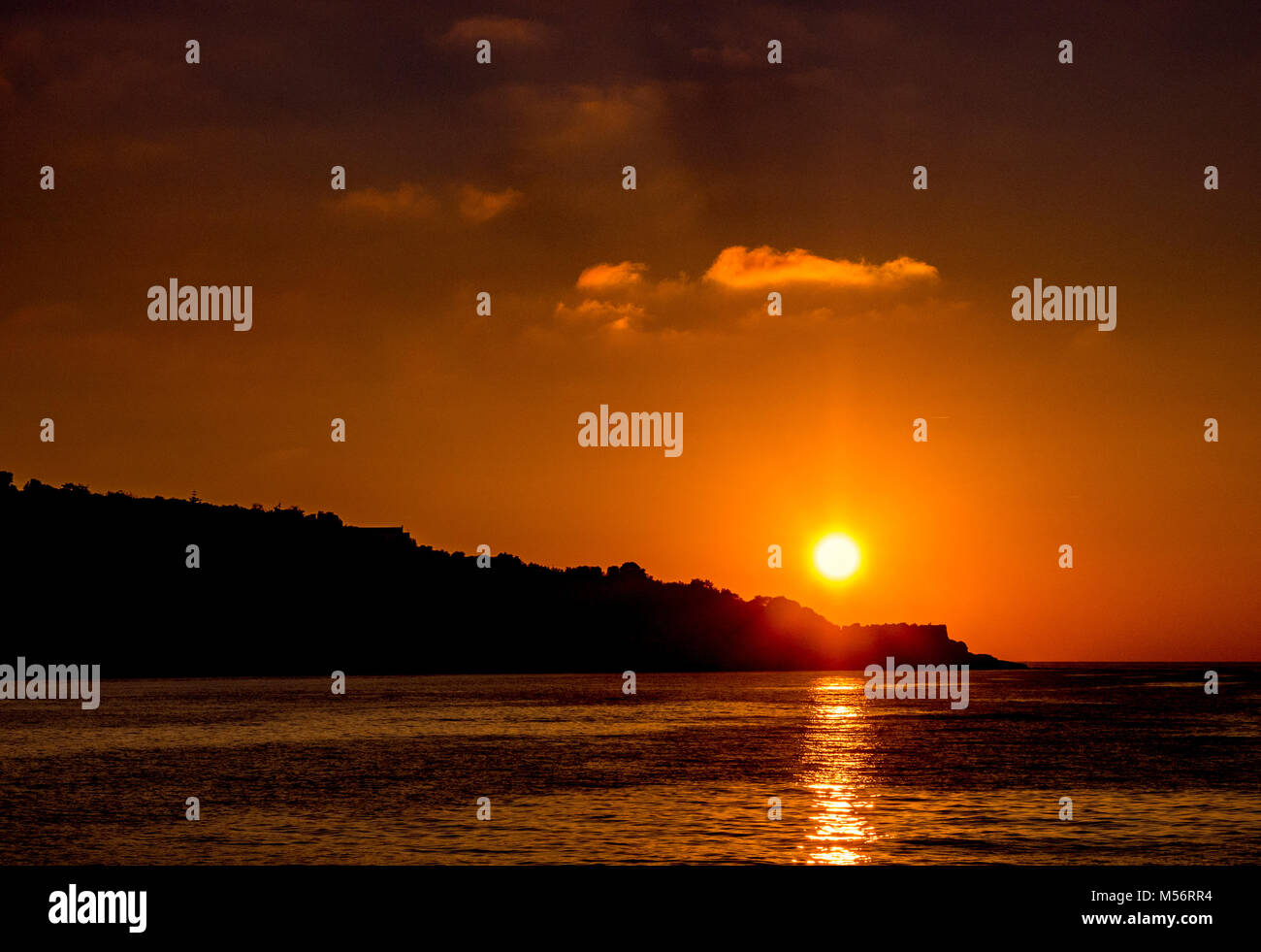Sunset over the Sorrento Peninsula, Bay of Naples, Italy. - Stock Image