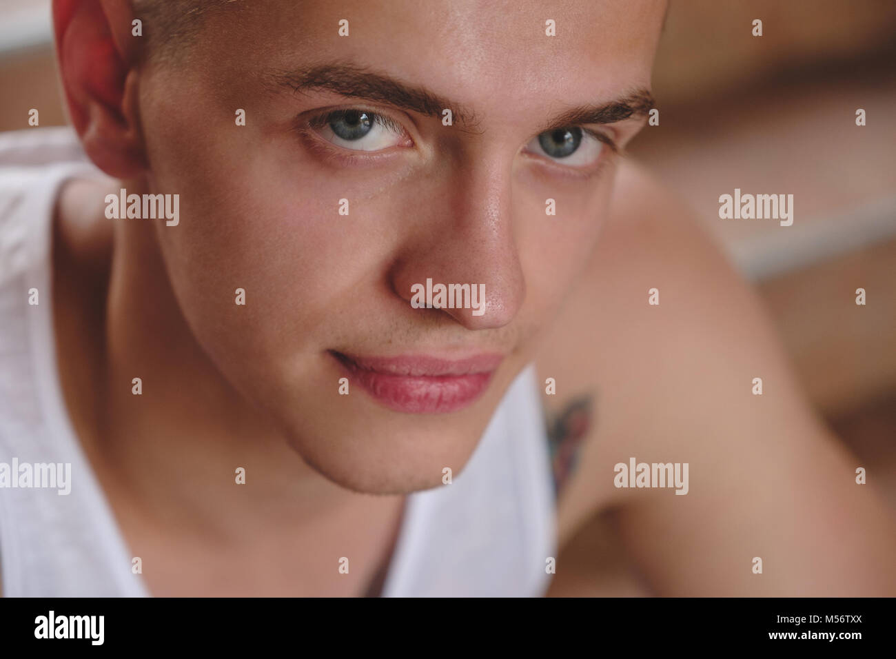 Focused look, face close-up portrait young man - Stock Image