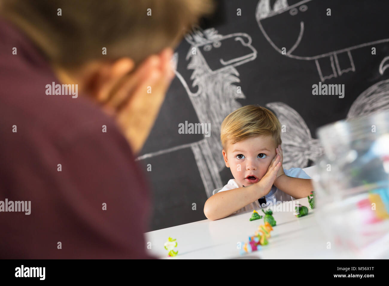 Cute little toddler boy at child therapy session. - Stock Image
