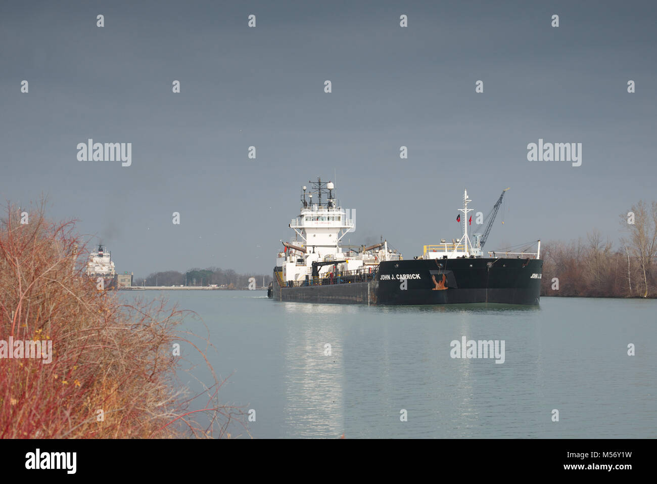 John J. Carrick Lake Freighter passing through the Welland Canal - Stock Image