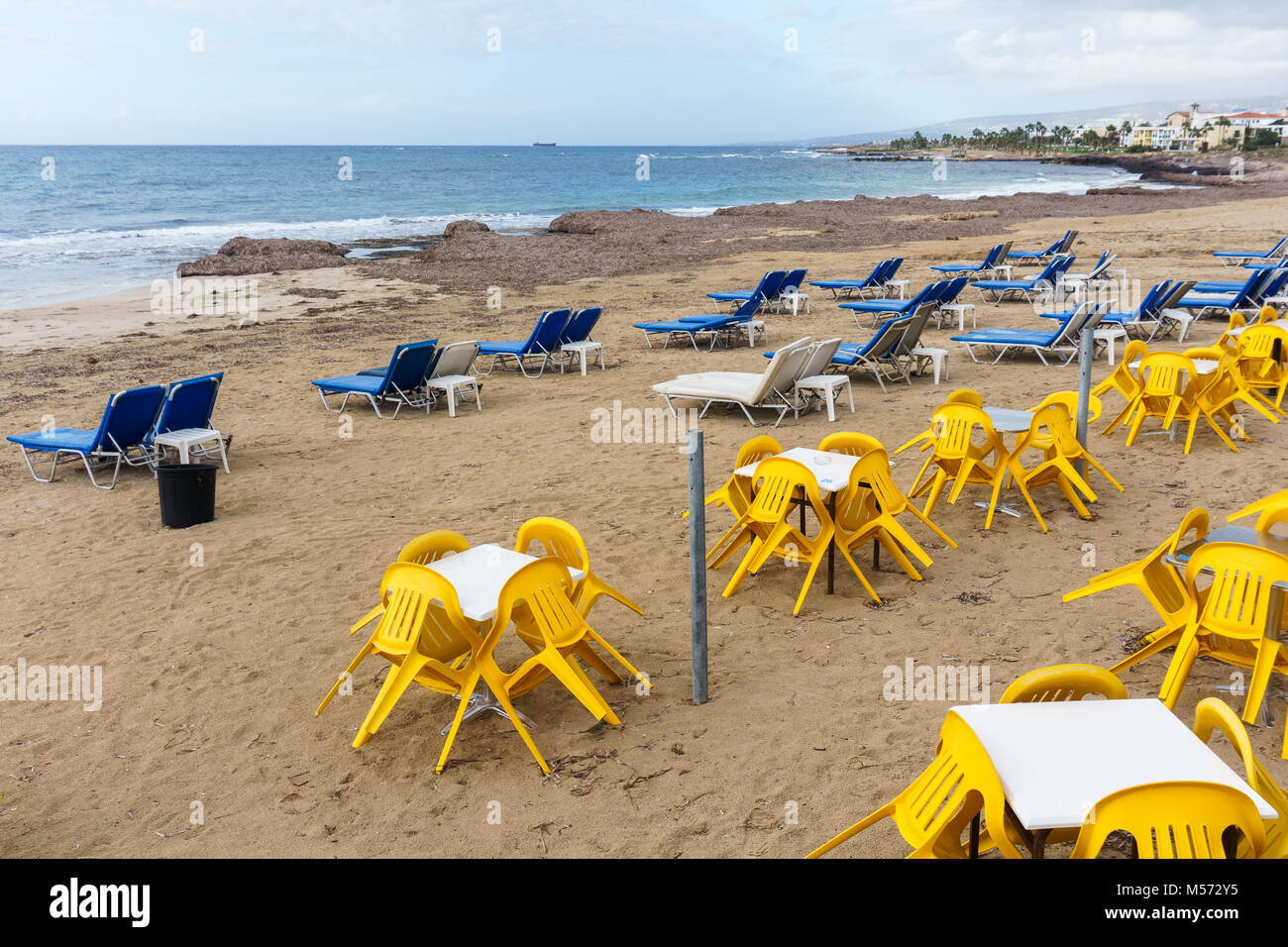 Photos of coastal zone with sun loungers and tables - Stock Image