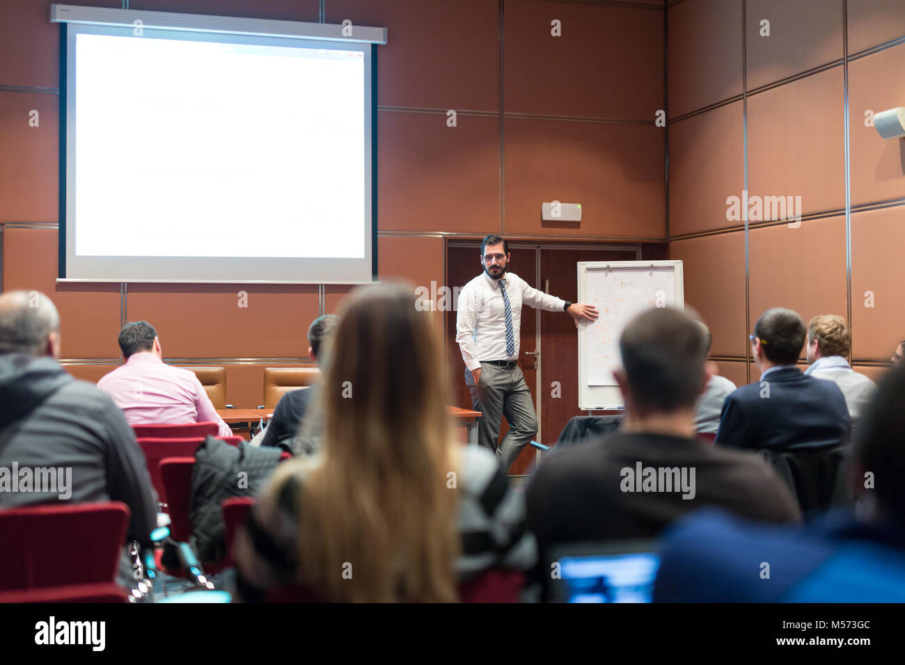 Speaker Giving a Talk at Business Meeting. - Stock Image