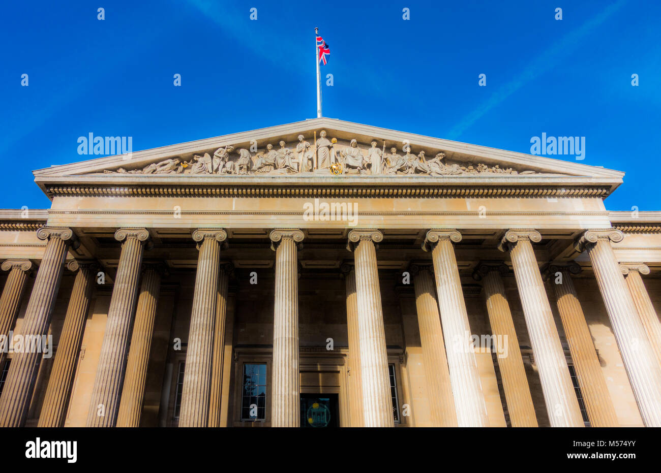 Closeup of portico and pediment sculptures at main entrance of British Museum (dedicated to human history, art and - Stock Image