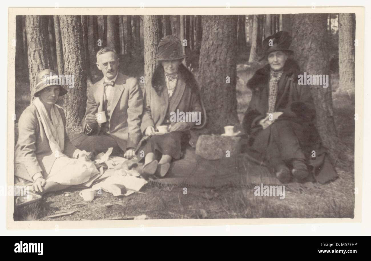 Photograph of men and women having a picnic in woods circa 1920s, U.K. - Stock Image