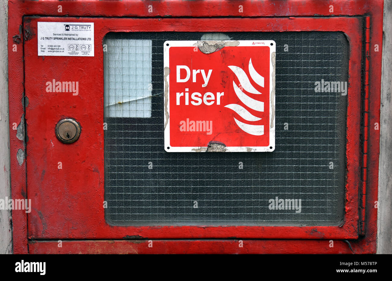 a dry riser cabinet access door on the outside of a london high rise block of flats. fire prevention firefighting - Stock Image