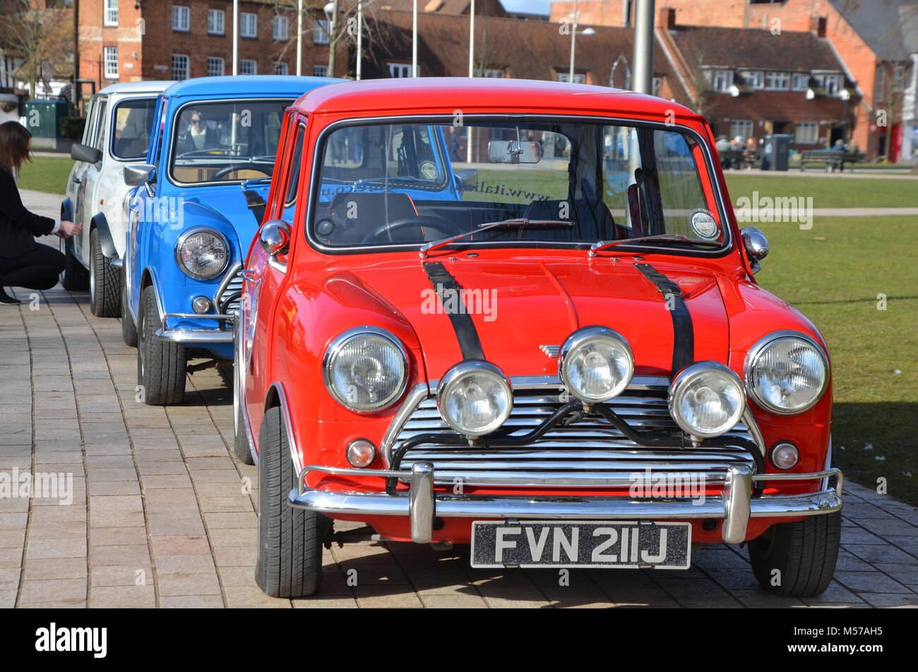 a red white and blue row of mini cooper cars GB - Stock Image