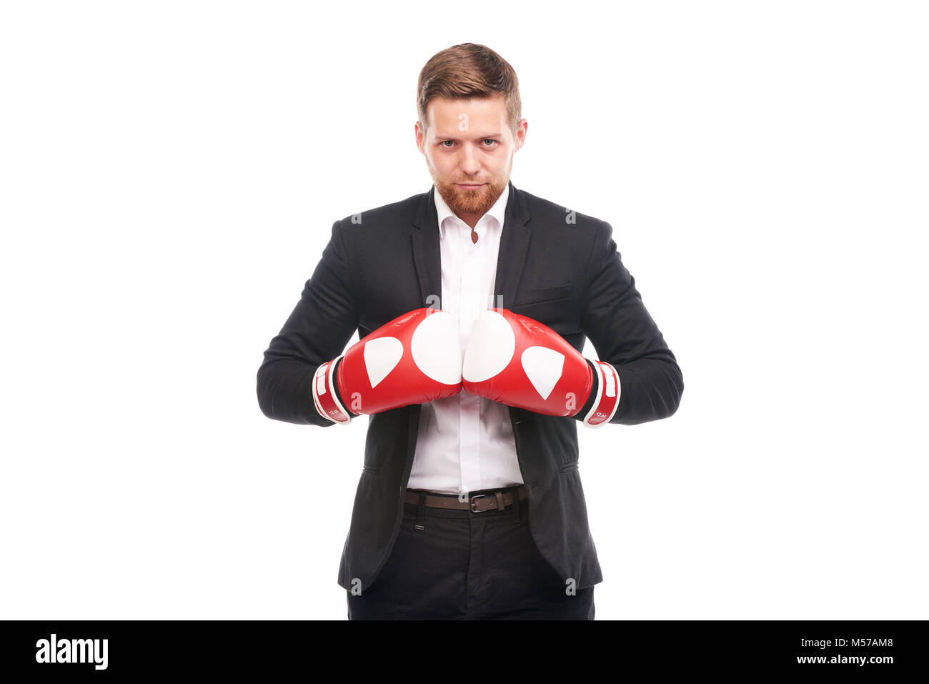 Businessman in boxing gloves - Stock Image