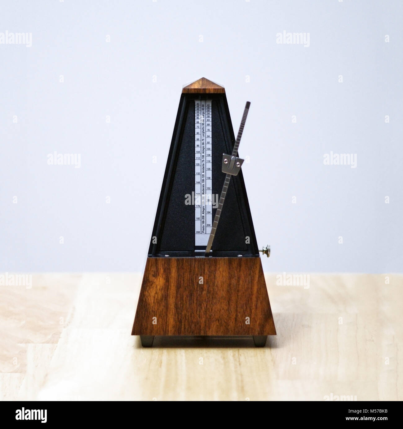 Metronome in action, closeup, isolated and on a plain background. Calgary, Alberta, Canada. - Stock Image