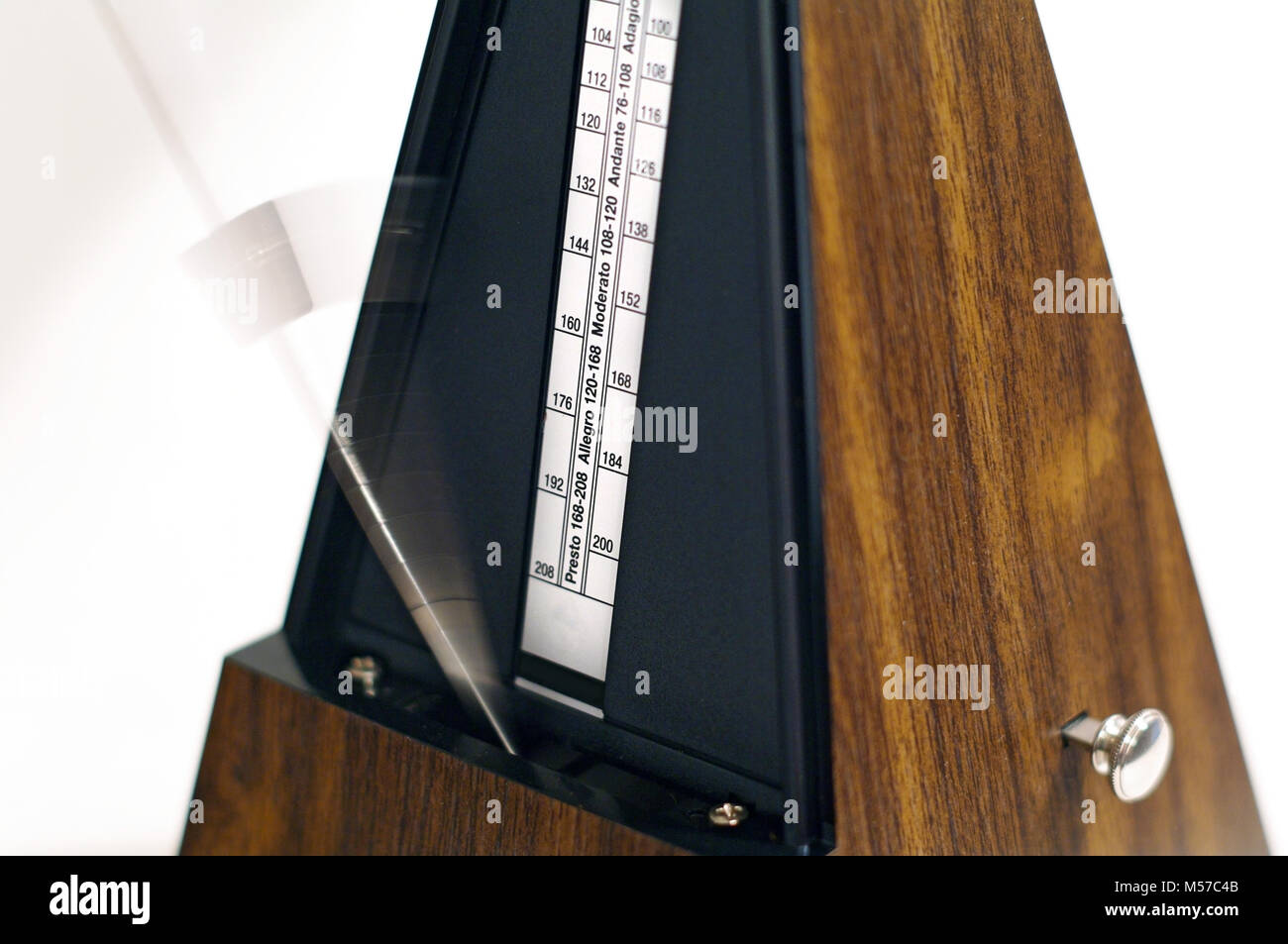 Metronome in action isolated and on a plain background. Calgary, Alberta, Canada. - Stock Image