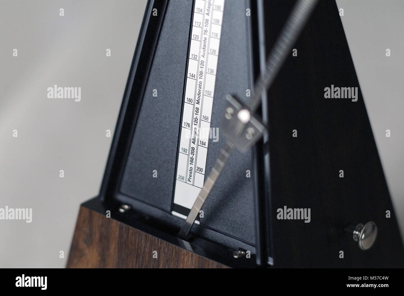 Metronome closeup in action isolated and on a plain background - Stock Image