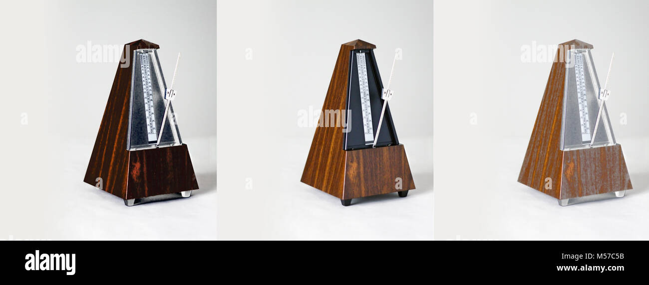 Metronome collage closeup on plain background. Calgary, Alberta, Canada. - Stock Image