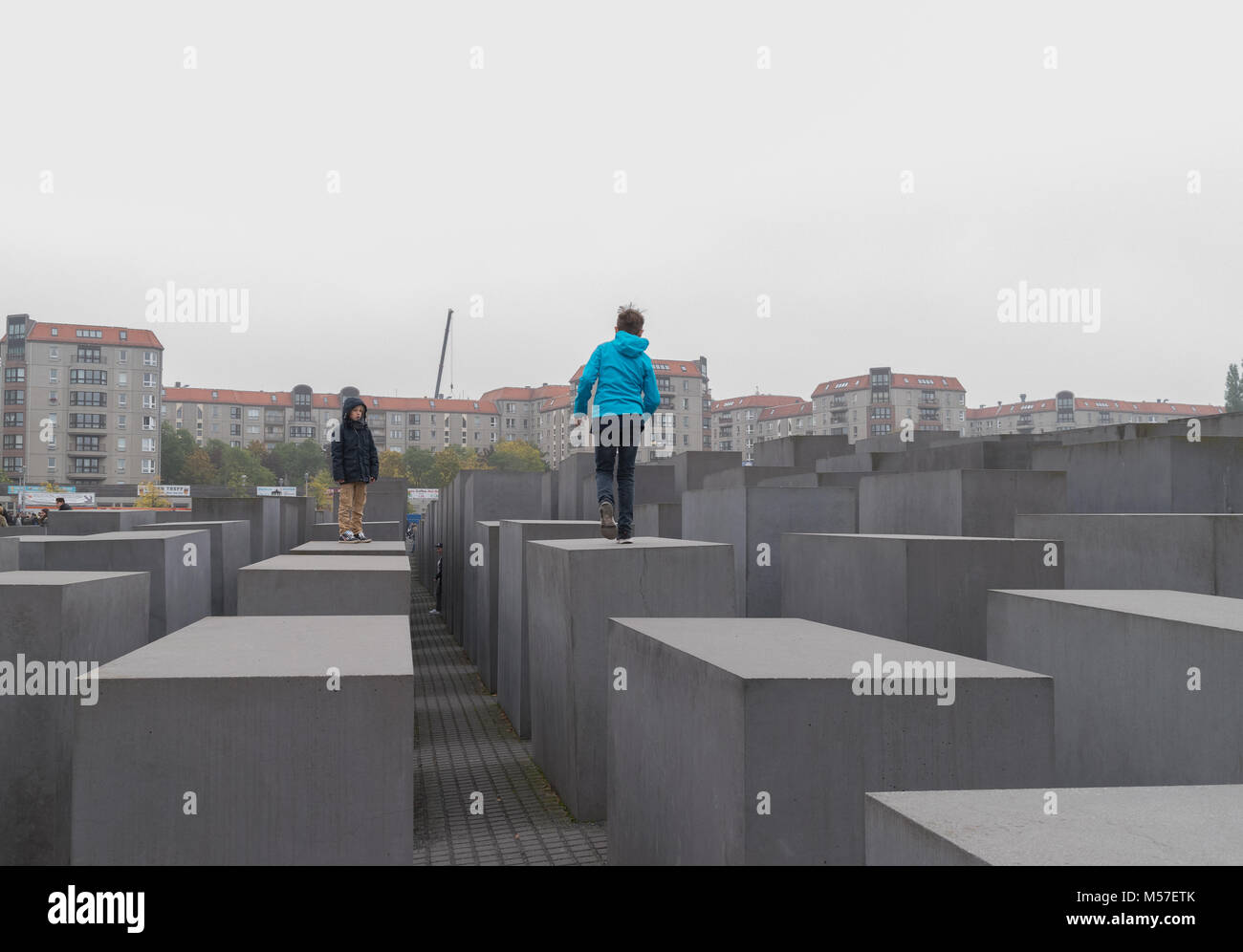 BERLIN - OCTOBER 18, 2016:  Playing on the stones of the Memorial to the Murdered Jews in Berlin - Stock Image