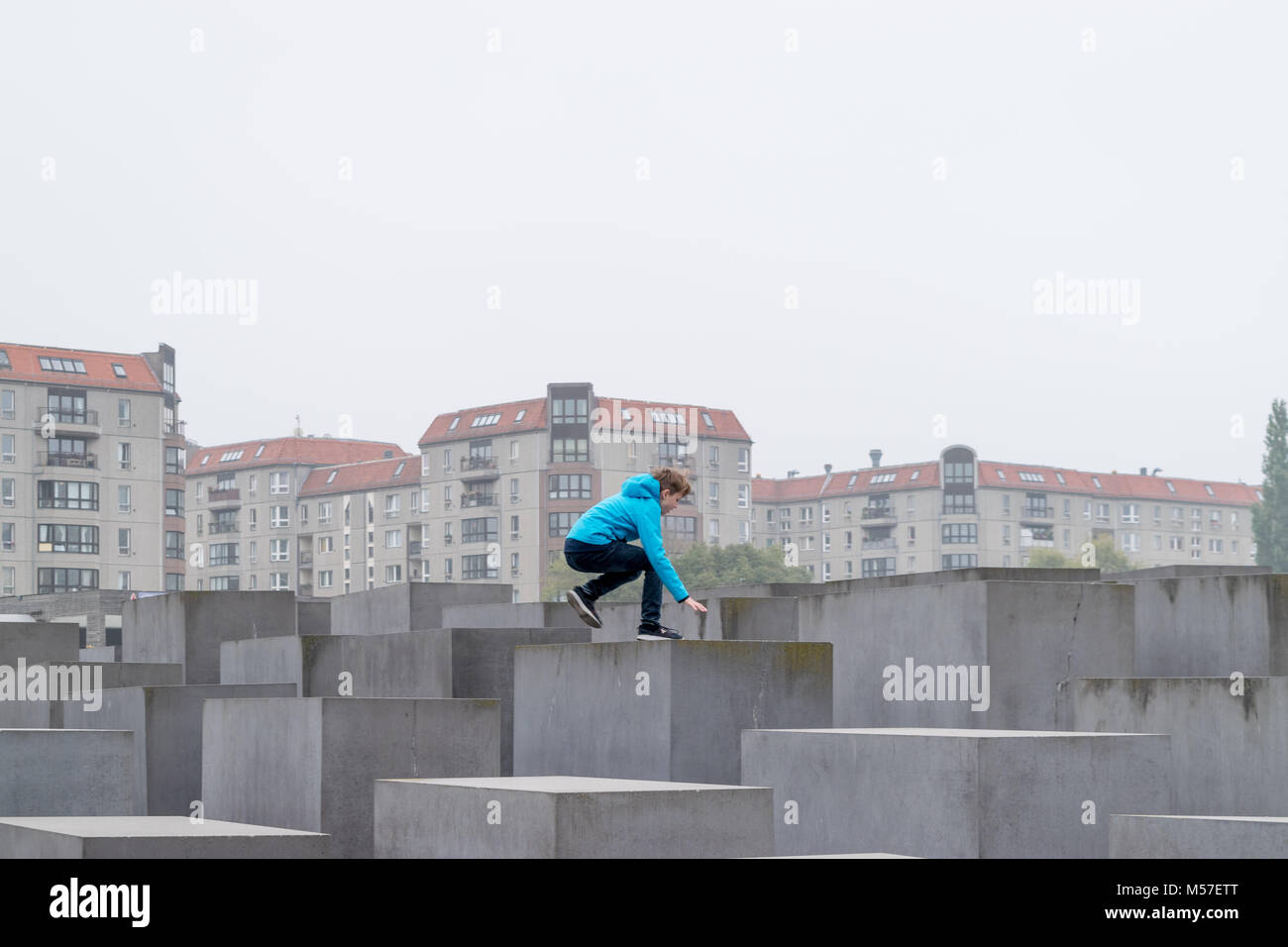 BERLIN - OCTOBER 18, 2016: Trying to climb the stones from the Memorial to the Murdered jews in Berlin - Stock Image