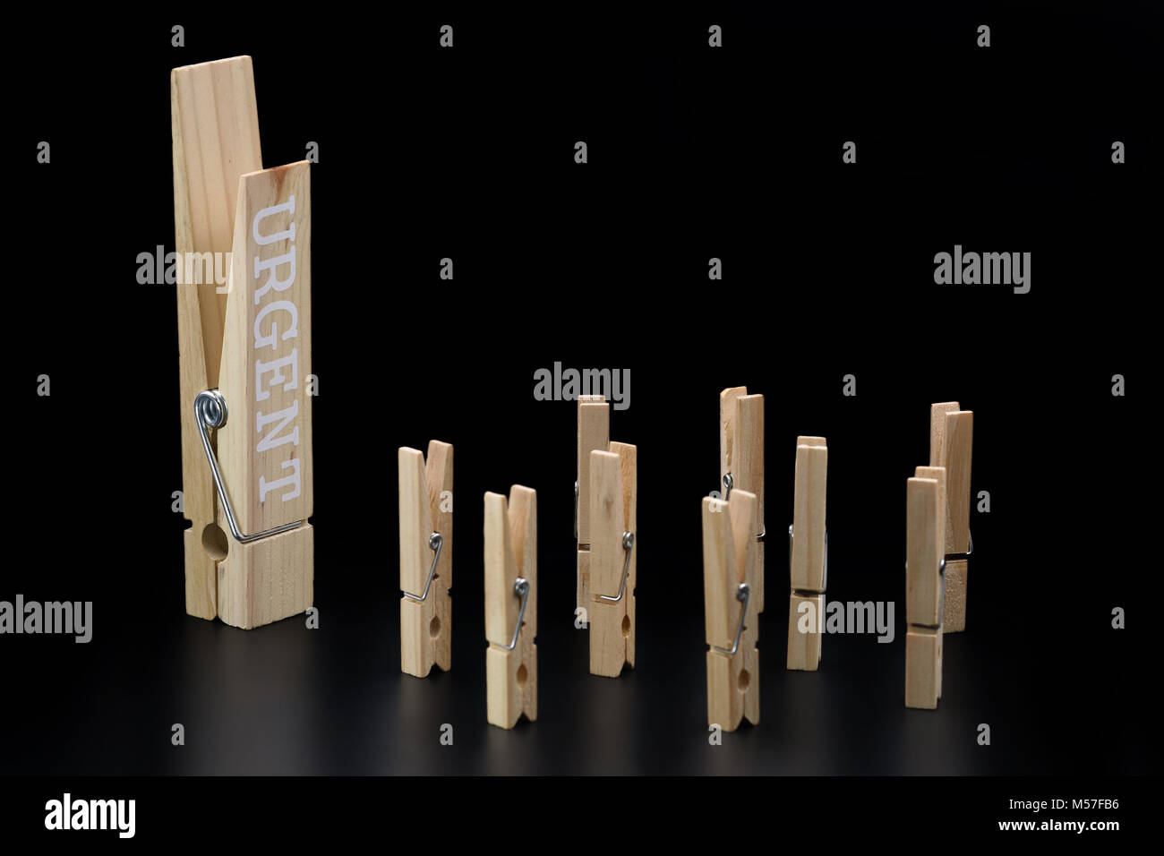 urgent clothespin issued commands isolated on black - Stock Image
